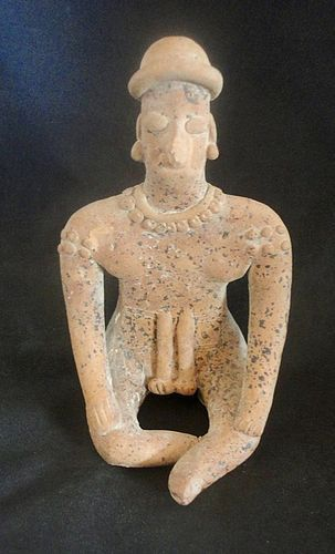 AN ELEGANT SEATED COLIMA GINGERBREAD FIGURE FROM WEST MEXICO