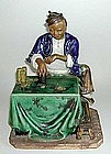 CHINESE CERAMIC FIGURE OF A YOUNG MAN, SIGNED