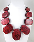 Unusual GG Bones Burgundy Pearlized Resin Necklace
