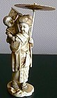 Japanese ivory okimono of a beauty with umbrella