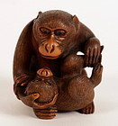 Boxwood Okimono of a Monkey Holding its Little. Signed Ikko