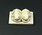 china 20th c pair rabbits toggle