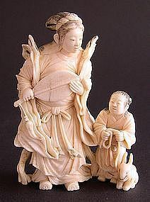Japanese ivory okimono gatten with hare and attendant