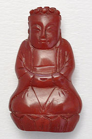 A Rare Chinese Amber Carved Seated Buddha