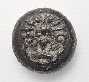 A Round Shaped Talisman Of A Seated Buddha