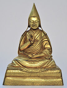 A Sino-Tibetan Gilt Bronze Lama
