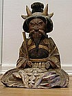 Wooden figure of seated old man, Japan