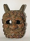 Large mask of a demon, wood, Japan 19th century