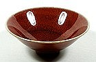 Sake cup, stoneware with oxblood glaze, Japan, 20th c.