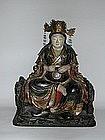 Sitting Shichimen Daimyojin, wood, Japan, 19th c.