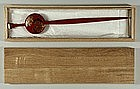 Hair pin, red lacquered wood, Japan