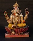 Antique Hindu marble statue of Ganesha seated on a lotus with his rat