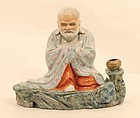 Chinese  porcelain figure, of a luohan draped in monastic robe