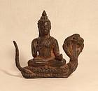 Khmer style Bronze Buddha on a Naga