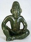 Antique Olmec style carved jade seated figure of a Lord