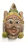 East Indian polychromed mask of the fair-skinned Balarama
