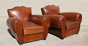 Olivier French Mustache backed leather Club Chairs