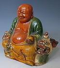 Chinese Antique Sancai Glaze Seated Budai on Kirin
