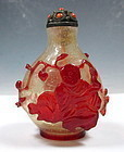 Peking Glass Snuff Bottle With Carvings Of A Man