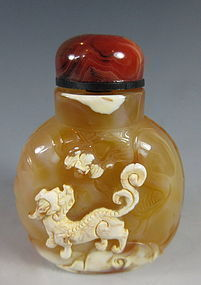 Chinese Agate Snuff Bottle with Old Man and Fu-dog