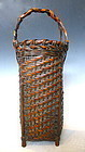 Antique Japanese woven tall basket