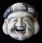 Large and dramatic Japanese Ceramic Mask of Daikoku