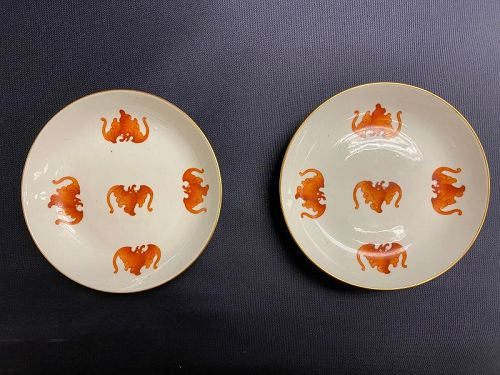 Pair of Imperial Tongzhi mark and period iron red five bats dishes