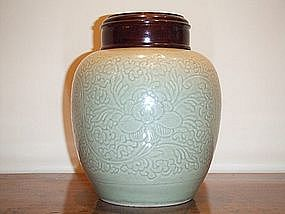 FINE AND RARE KANGXI PERIOD CARVED CELADON OVOID JAR