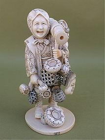 Japanese  Ivory Okimono Woman merchant by Ta Naka