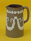 English Stoneware pitcher lion and grape appliqué