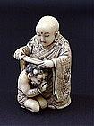 Japanese Ivory Netsuke Buddha and Oni artist signed