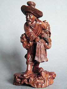 Carved Hardwood Figure of a Fisherman circa 1920-1960