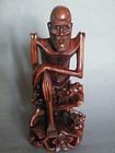 Chinese Carved Hardwood Figure of Li Tieguai, circa 1880 - 1920