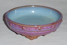 A Rare Rosy Glazed Junyao Washer with Drum-Stud Motifs and Ruyi Legs