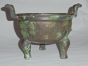 A Rare Zhou Dynasty Bronze Ding Vessel with Archaic Motifs