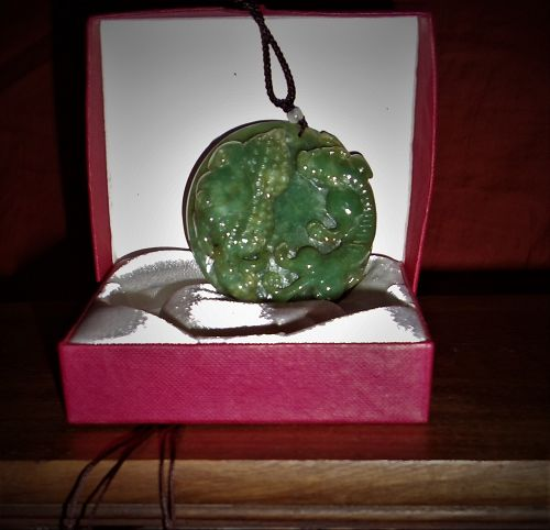 An Exquisite Green Jade Pedant with Auspicious Relief-Motifs