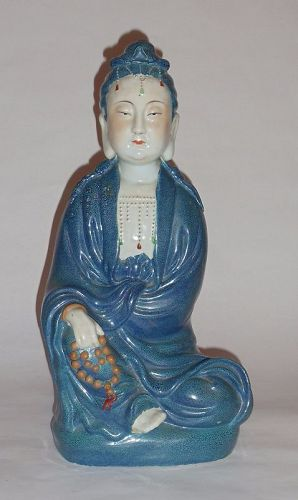 A Qing  Qianlong Rubin-Egg-Blue Glazed Guanyin