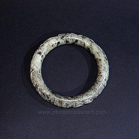 A Rare Chinese Liao or XiXia Jade Bangle with Horses - circa 1000 AC
