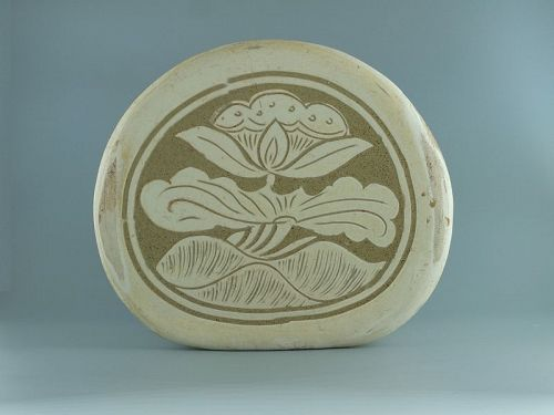 A Chinese Cizhou carved lotus pillow, Song dynasty