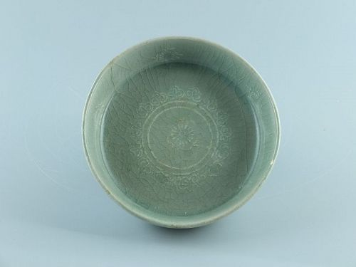 A Korean, inlaid slip, celadon shallow dish, Goryeo dynasty