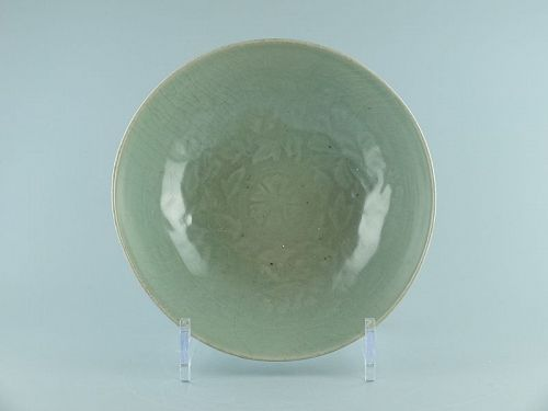 A Korean Celadon Bowl With Moulded Floral Decoration, Goryeo Dynasty