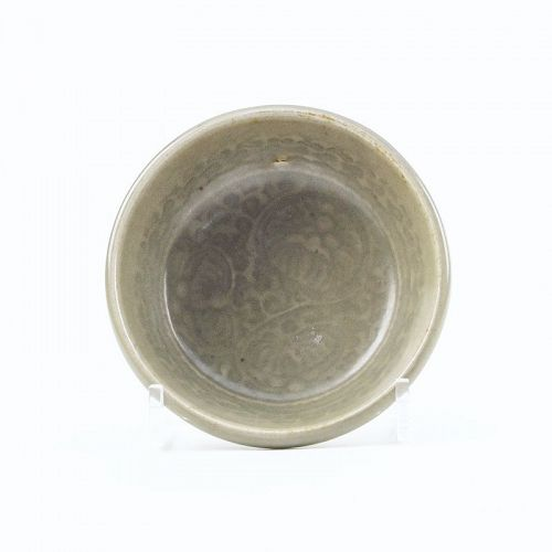 A small Yaozhou moulded dish, C11-12th
