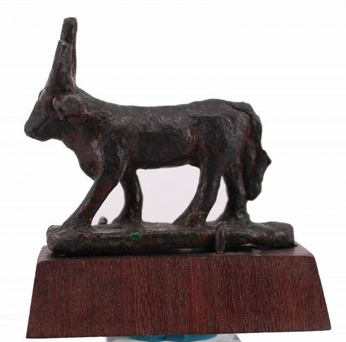 Ancient egyptian bronze apis bull statuette on a wooden base