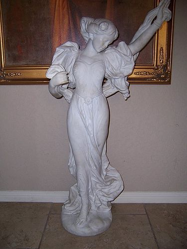 A Fine and Large Carved Marble Sculpture of a Maiden,  circa 1900