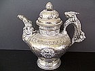 A Tibetan Ewer with Repousse Work and Makara Handles