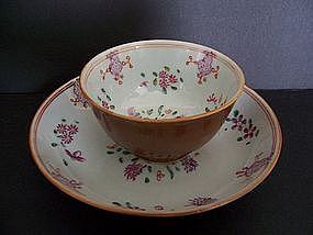 A Qianlong (1736-1795) Famille Rose Teacup and Saucer