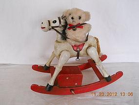 ENESCO VINTAGE MUSIC BOX ROCKING HORSE WITH TEDDY BEAR