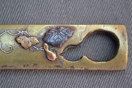 Kozuka  brass cutted pumpkin mixed metal.