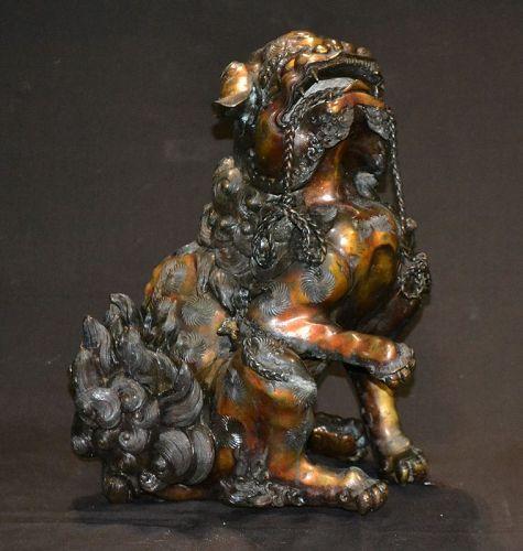 Buddhist lion in gilded bronze
