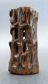 Spill vase in the form of a stylized tree trunk